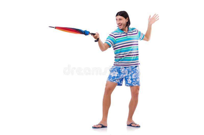 Hombre positivo con el paraguas colorido aislado encendido imagenes de archivo