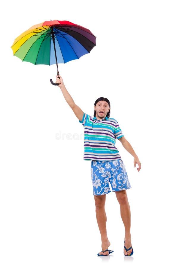 Hombre positivo con el paraguas colorido aislado encendido fotos de archivo libres de regalías