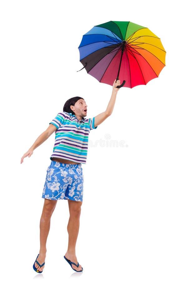 Hombre positivo con el paraguas colorido aislado encendido imagen de archivo