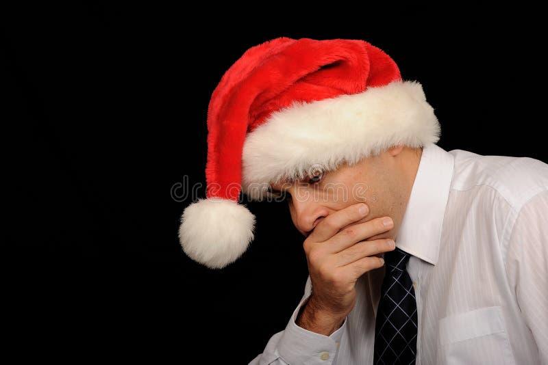 Hombre preocupante de la Navidad fotos de archivo