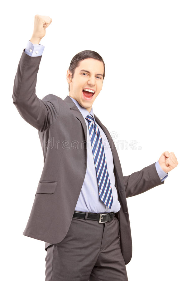 Hombre profesional joven emocionado que gesticula felicidad imágenes de archivo libres de regalías