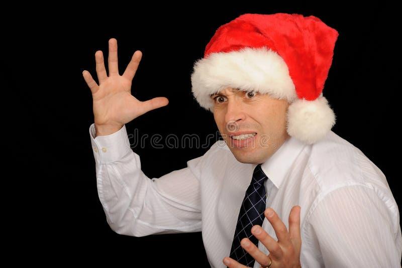 Hombre que desgasta el sombrero de Santa fotos de archivo libres de regalías