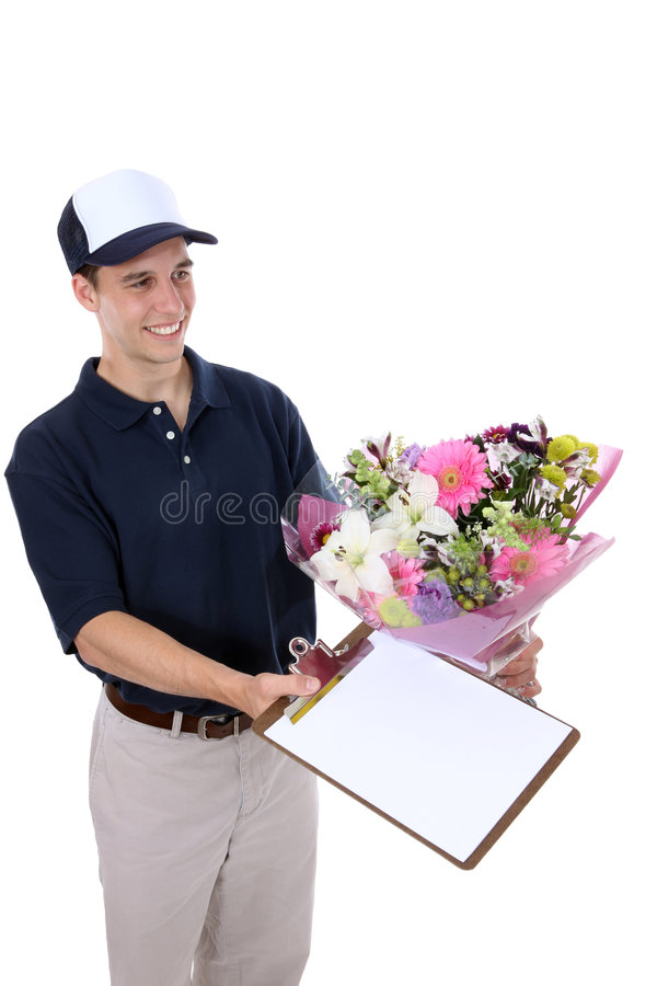 Hombre que entrega las flores foto de archivo libre de regalías