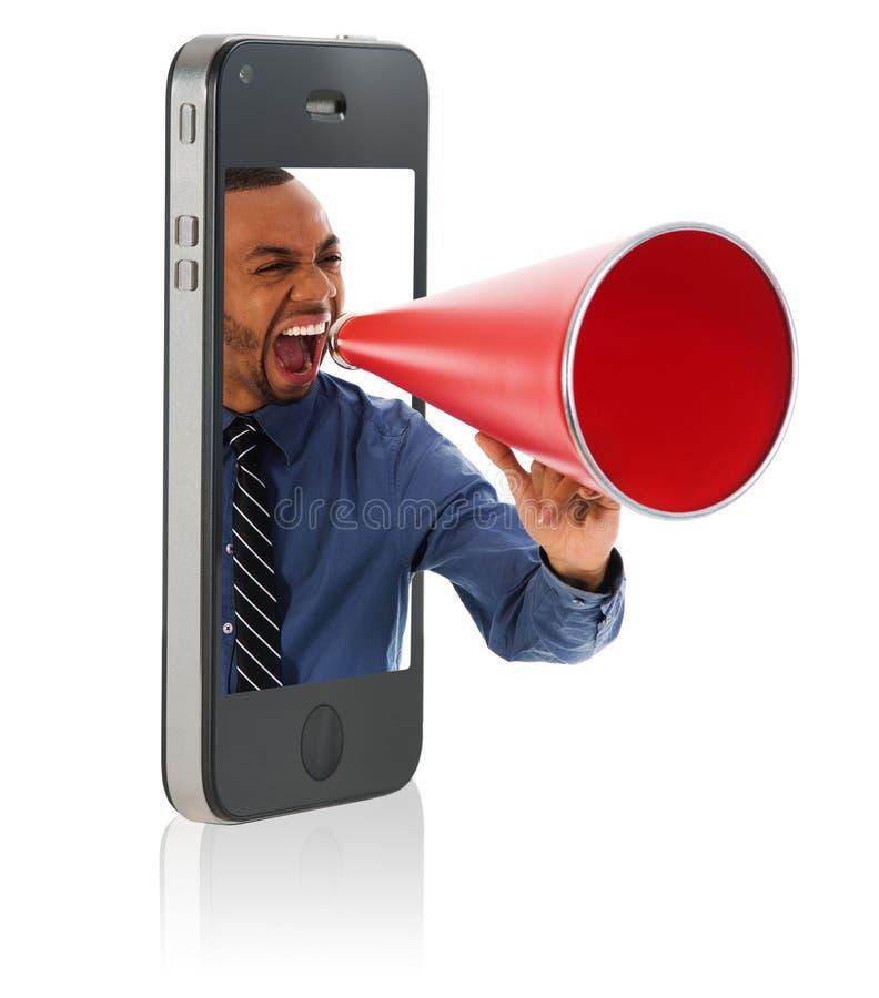 Hombre que grita en megáfono imagenes de archivo