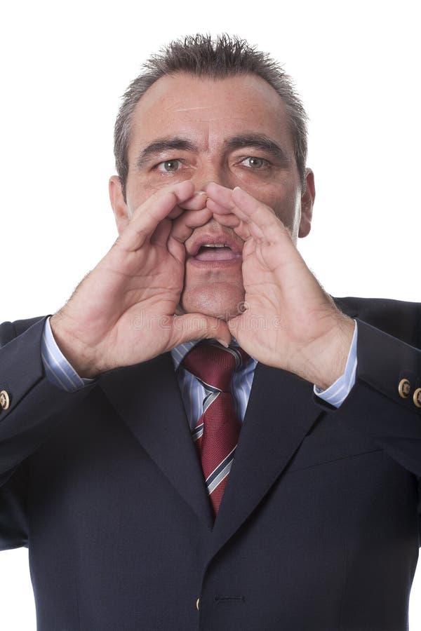 Hombre que grita hacia fuera ruidosamente imagen de archivo libre de regalías
