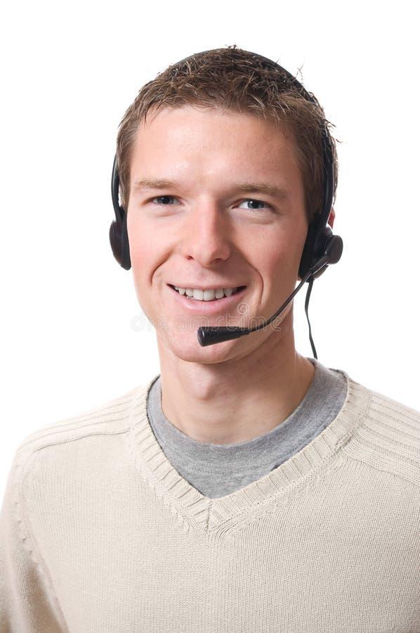 Hombre Que Habla Con El Receptor De Cabeza Fotografía de archivo libre de regalías