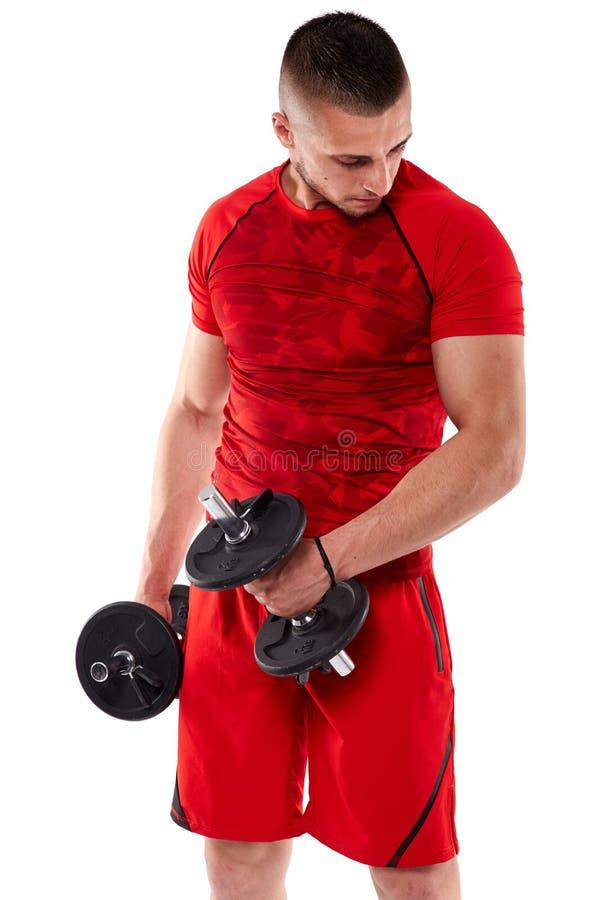 Hombre que hace entrenamiento del bíceps foto de archivo