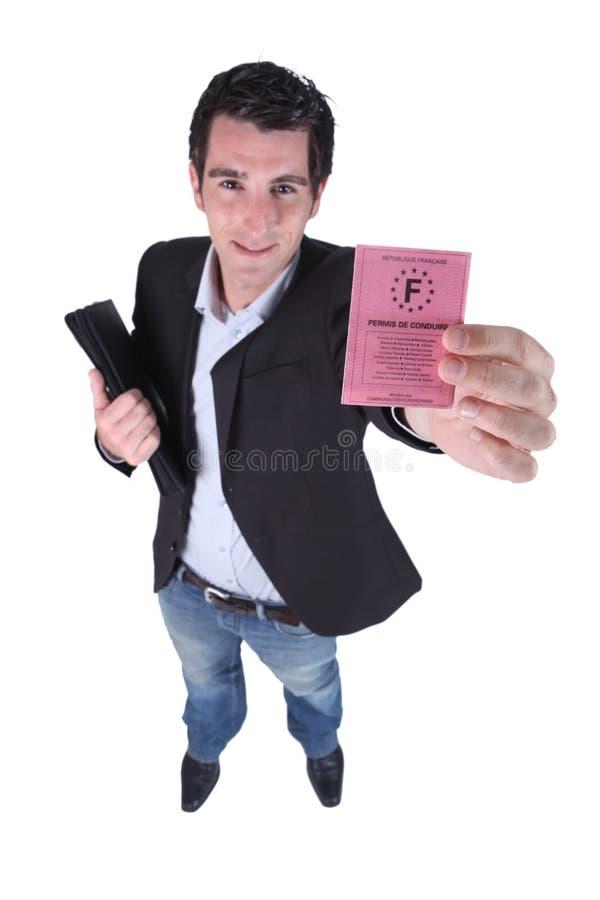 Hombre que lleva a cabo el documento oficial fotografía de archivo