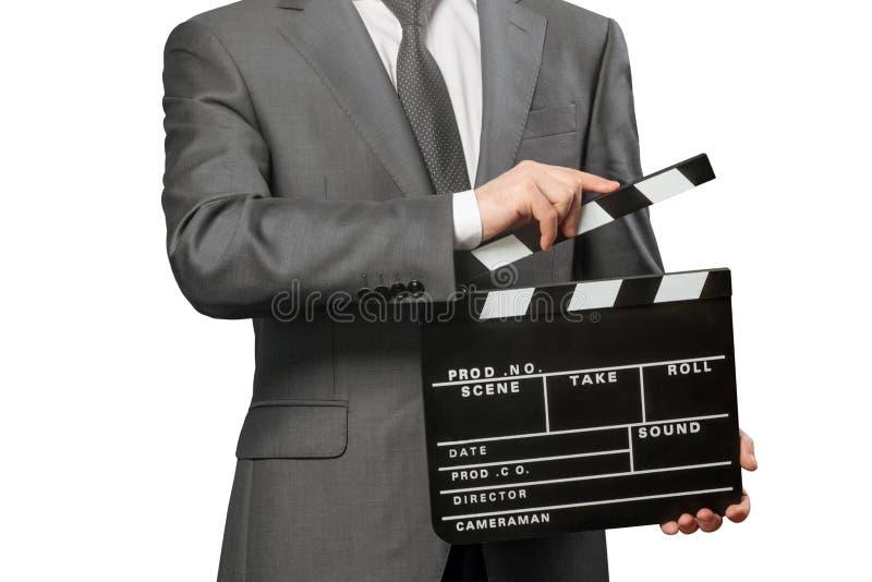 Hombre que lleva a cabo el tablero de chapaleta de la película en blanco foto de archivo libre de regalías