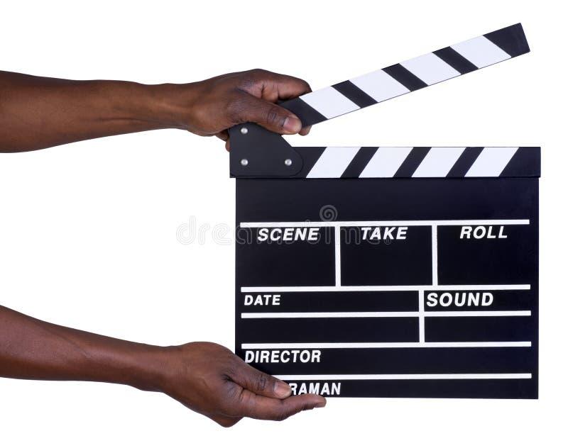 Hombre que lleva a cabo el tablero de chapaleta de la producción de la película foto de archivo