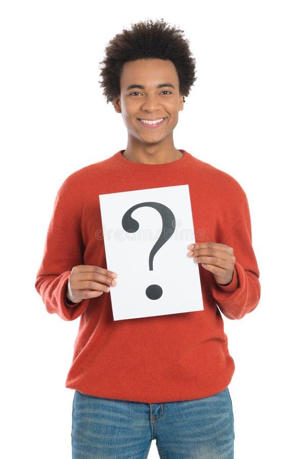 Hombre que lleva a cabo la pregunta Mark Sign foto de archivo libre de regalías