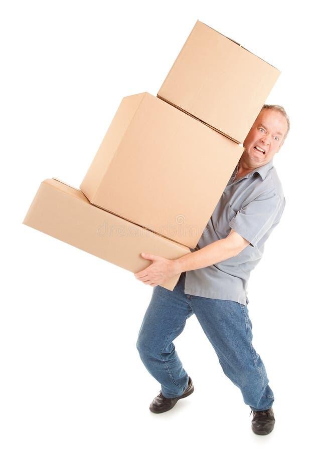 Hombre que lleva doloroso las cajas fotos de archivo