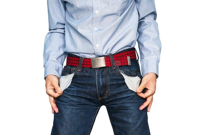 Hombre que muestra a sus bolsillos vacíos que demuestran lo no tiene ningún dinero fotos de archivo libres de regalías