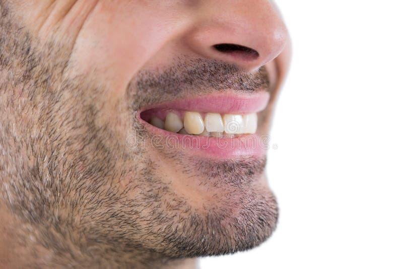 Hombre que muestra sus dientes imagenes de archivo