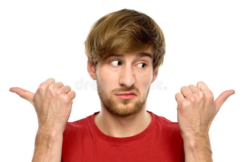 Hombre que señala en diversas direcciones fotos de archivo libres de regalías