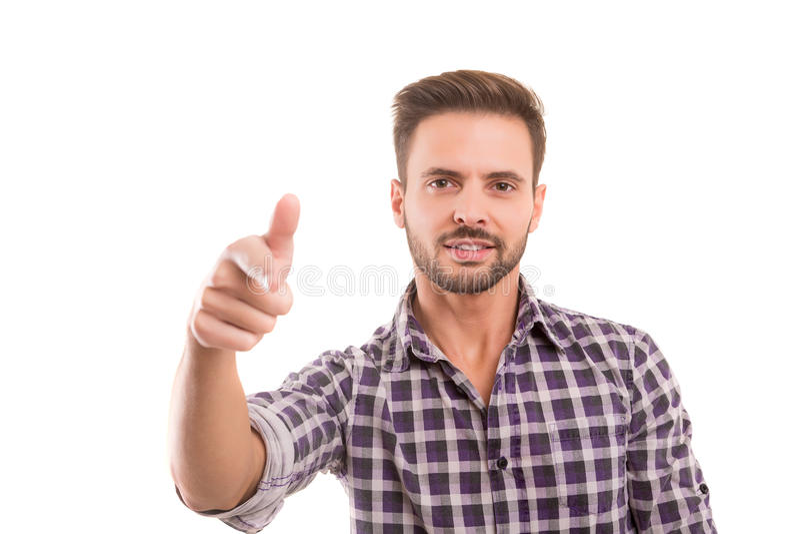 Hombre que señala muy bien fotografía de archivo libre de regalías