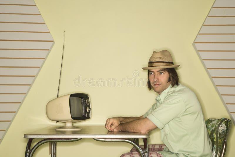 Hombre que se sienta en el vector. foto de archivo libre de regalías