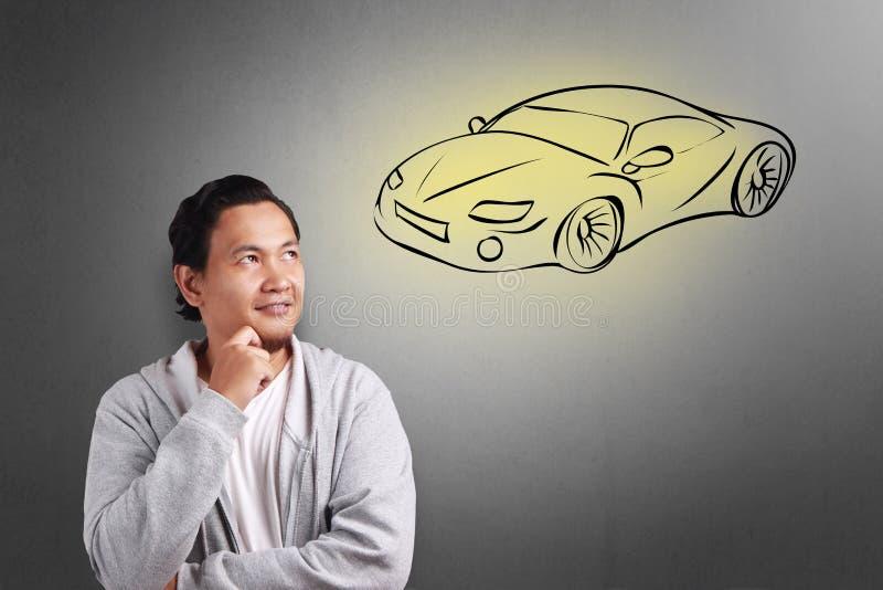 Hombre que sueña con el coche de deportes imagen de archivo libre de regalías