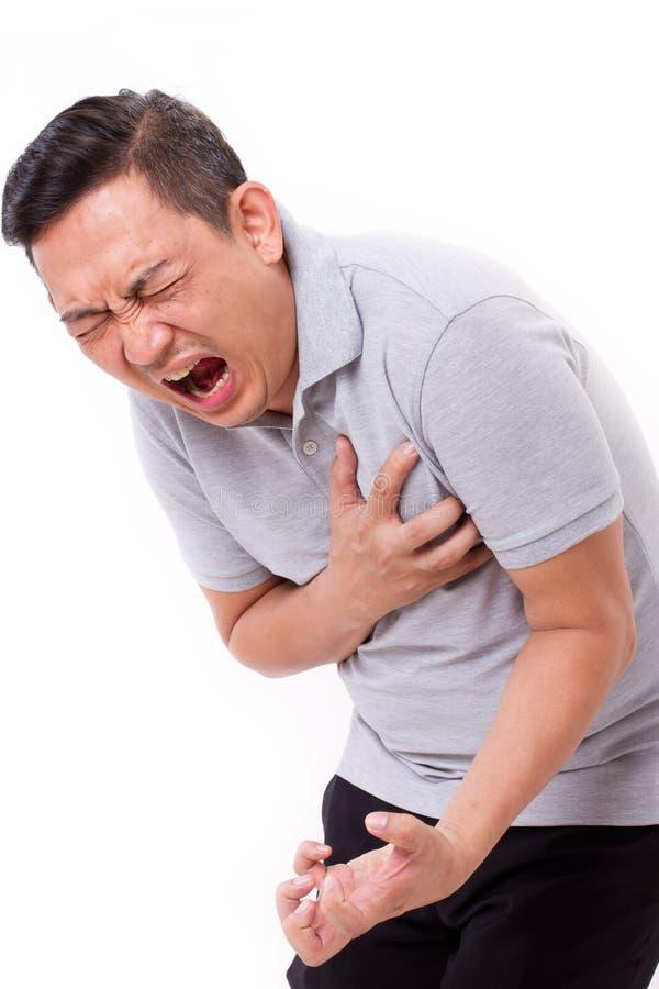 Hombre que sufre de ataque del corazón fotos de archivo