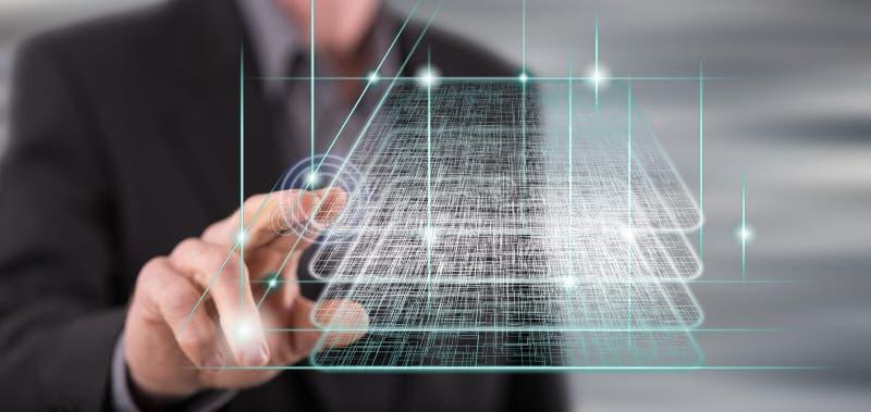 Hombre que toca un concepto de la tecnología del blockchain foto de archivo libre de regalías