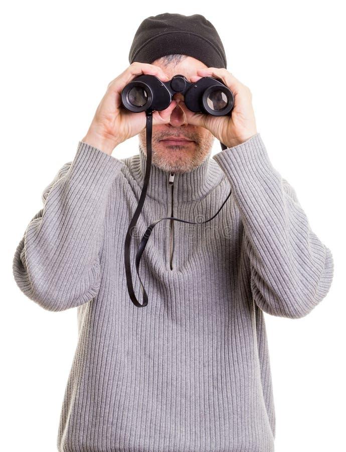 Hombre que usa los prismáticos imágenes de archivo libres de regalías