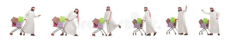 Hombre ?rabe que hace las compras aisladas en blanco imagen de archivo libre de regalías