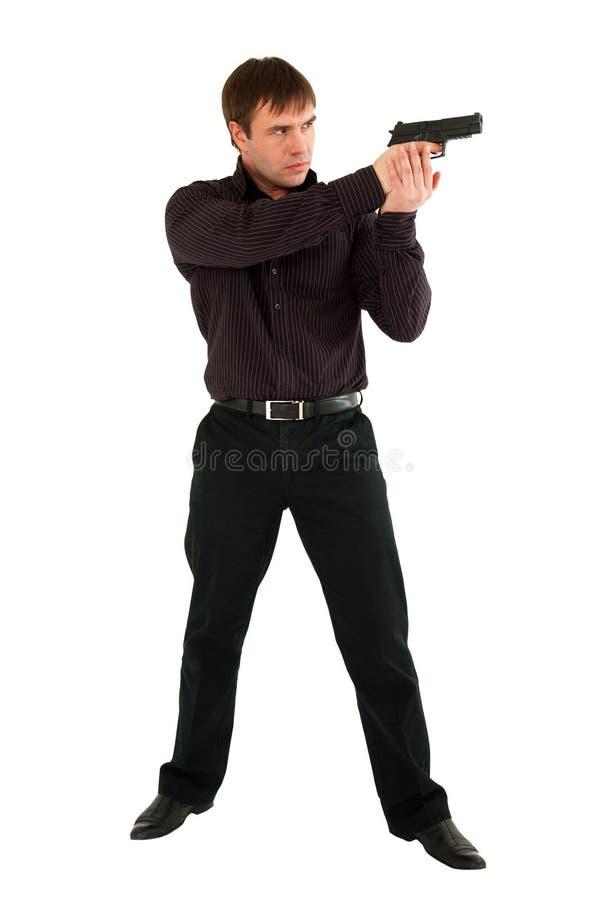 Hombre serio con un arma fotos de archivo
