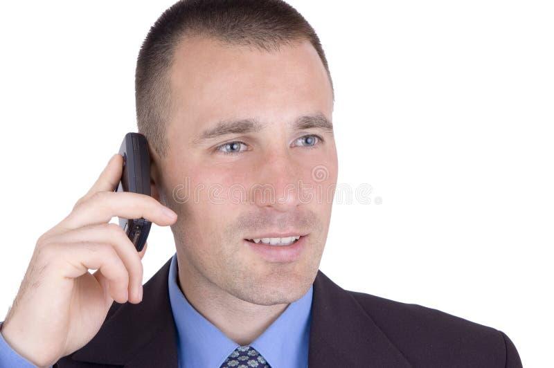 Hombre sonriente con el teléfono celular imagen de archivo libre de regalías