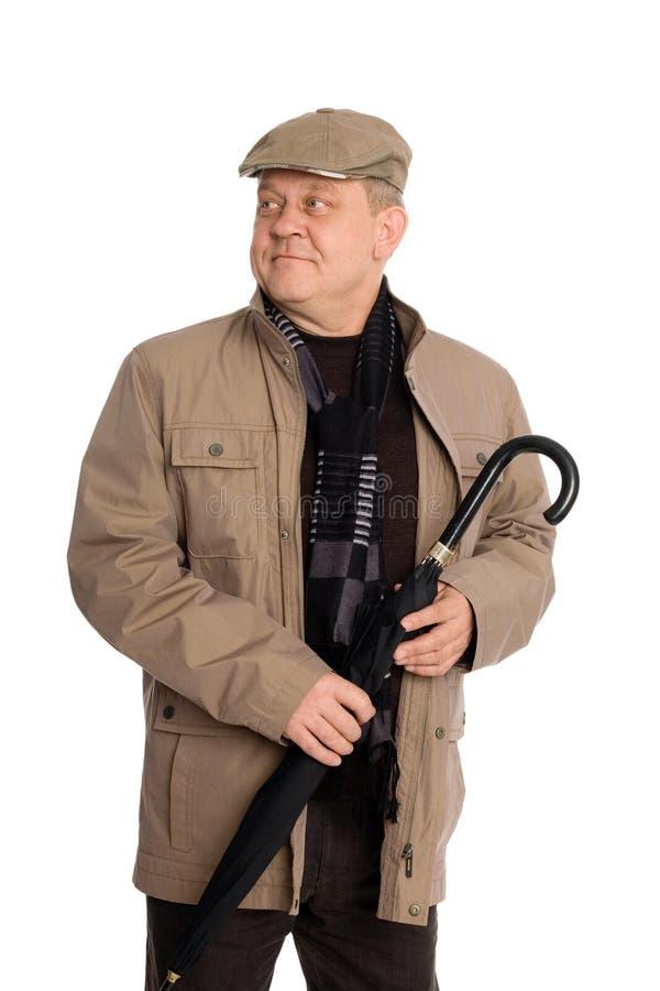 Hombre sonriente con estilo un paraguas. imágenes de archivo libres de regalías