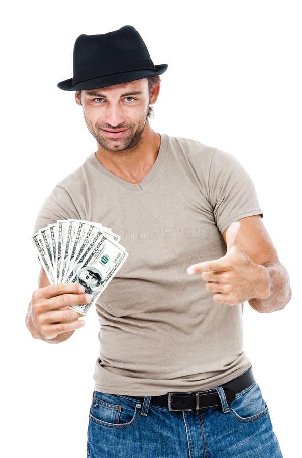 Hombre sonriente que sostiene el dinero imagenes de archivo