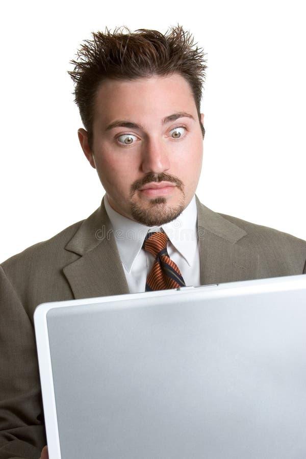 Hombre sorprendido de la computadora portátil imagen de archivo