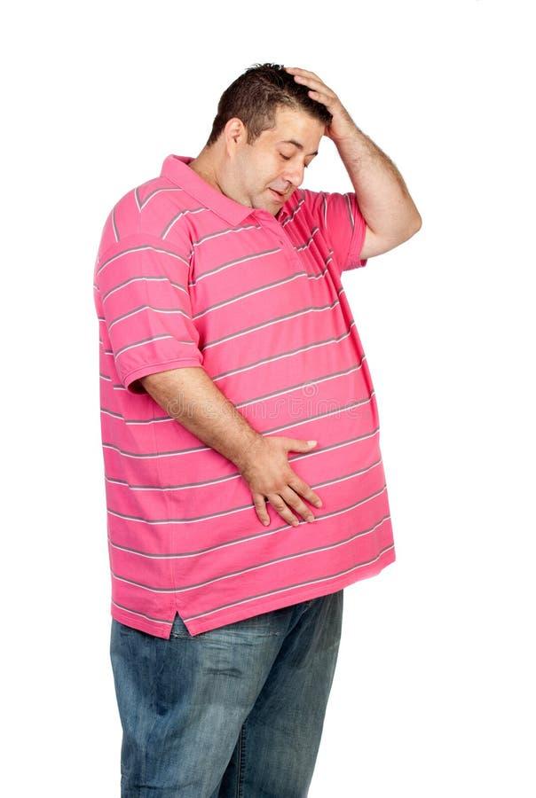 Hombre sorprendido de la obesidad foto de archivo