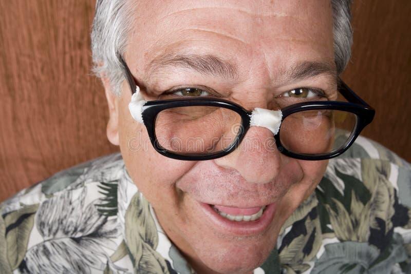 Hombre tonto con los vidrios sujetados con cinta adhesiva foto de archivo libre de regalías