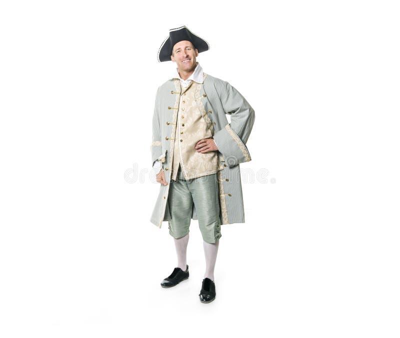 Hombre vestido como un cortesano o príncipe en el fondo blanco foto de archivo libre de regalías