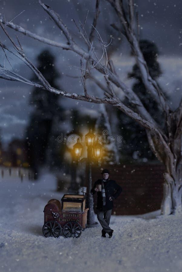 Hombre victoriano que vende las castañas con el carro asado de la castaña imagenes de archivo