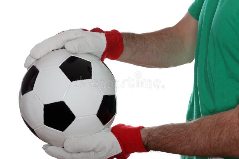 Hombre y balón de fútbol imagen de archivo libre de regalías