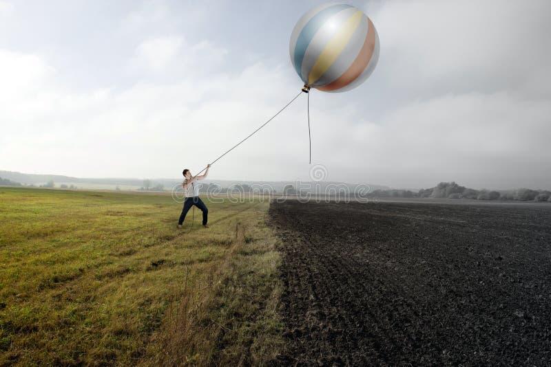 Hombre y globo foto de archivo