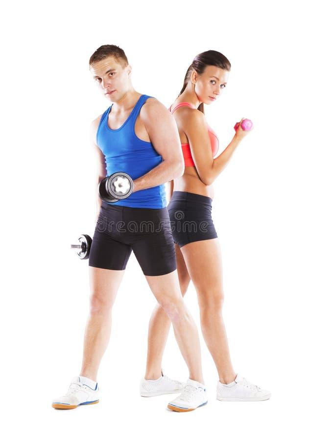 Hombre y mujer atléticos foto de archivo libre de regalías