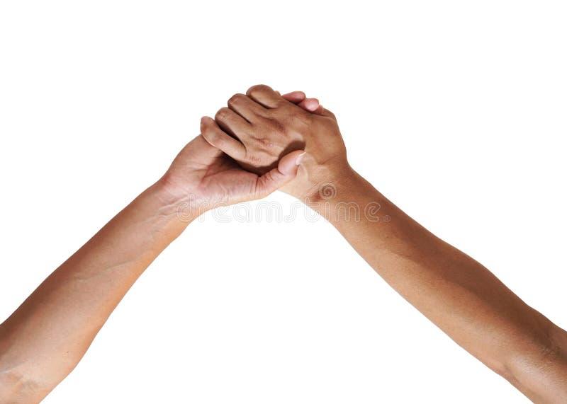Hombre y mujer - control de la mano del ` s del hombre por una mano de la muchacha aislada del fondo blanco foto de archivo libre de regalías