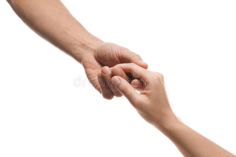 Hombre y mujer que llevan a cabo las manos en el fondo blanco, primer imágenes de archivo libres de regalías