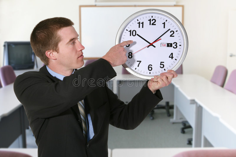 Hombre y reloj de negocios fotos de archivo libres de regalías