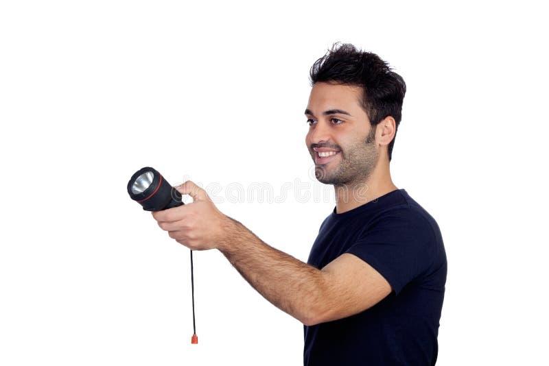 Hombres atractivos en negro con una linterna que busca algo foto de archivo libre de regalías
