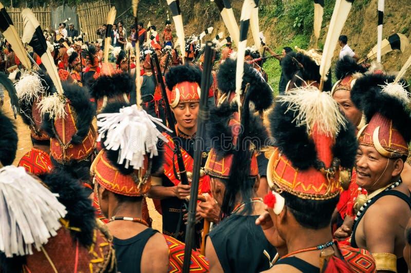 Hombres con las plumas imagen de archivo