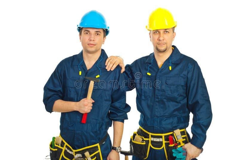 Hombres de los trabajadores del constructor de la belleza foto de archivo libre de regalías