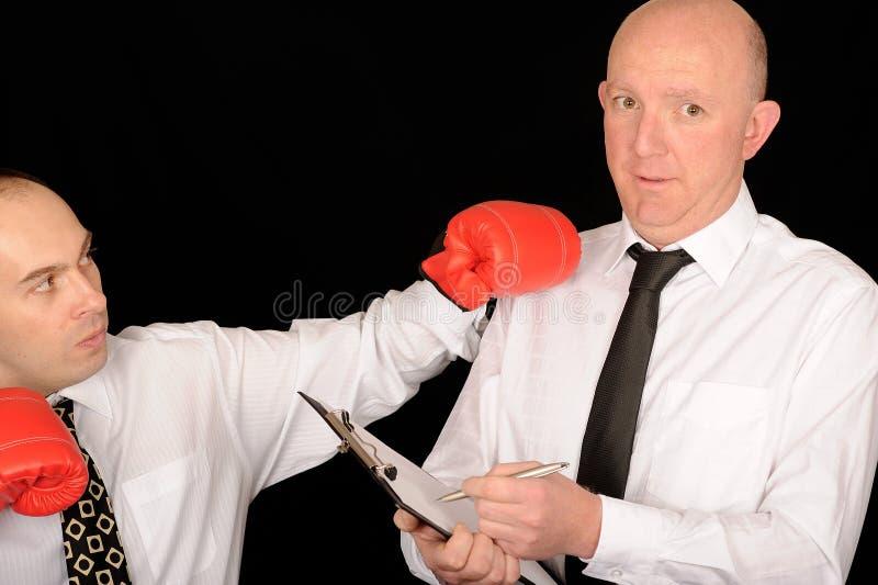 Hombres de negocios con los guantes de boxeo imágenes de archivo libres de regalías