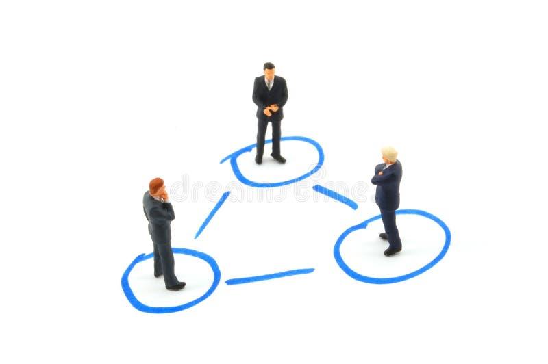 Hombres de negocios del establecimiento de una red imagenes de archivo