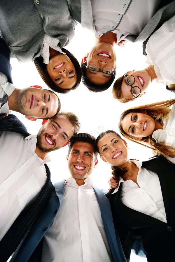 Hombres de negocios en un círculo que mira abajo fotografía de archivo libre de regalías