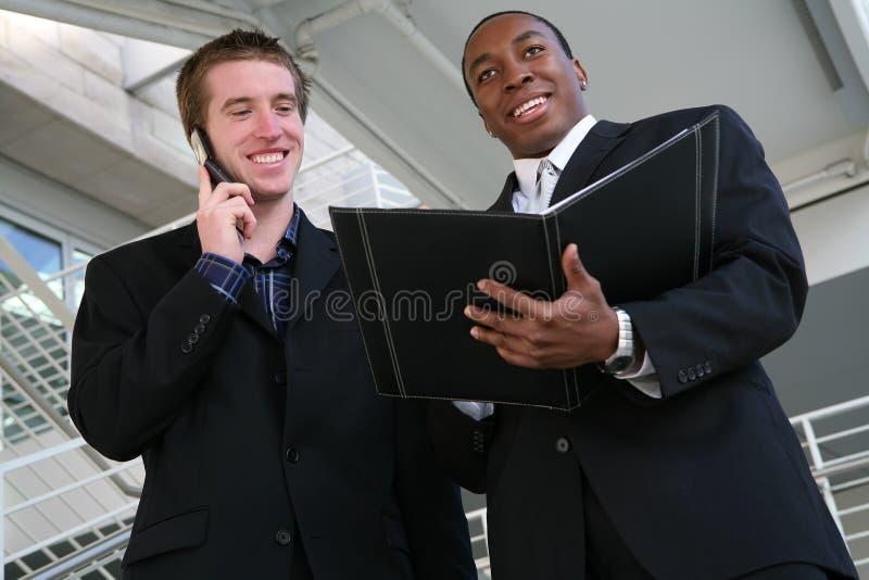 Hombres de negocios hermosos imagen de archivo libre de regalías