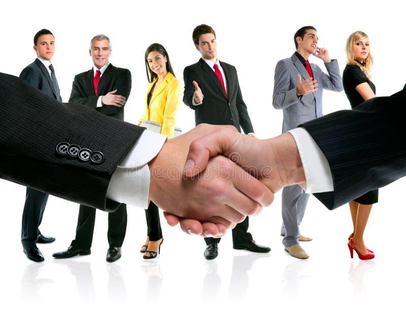 Hombres de negocios personas del apretón de manos y de la compañía imágenes de archivo libres de regalías