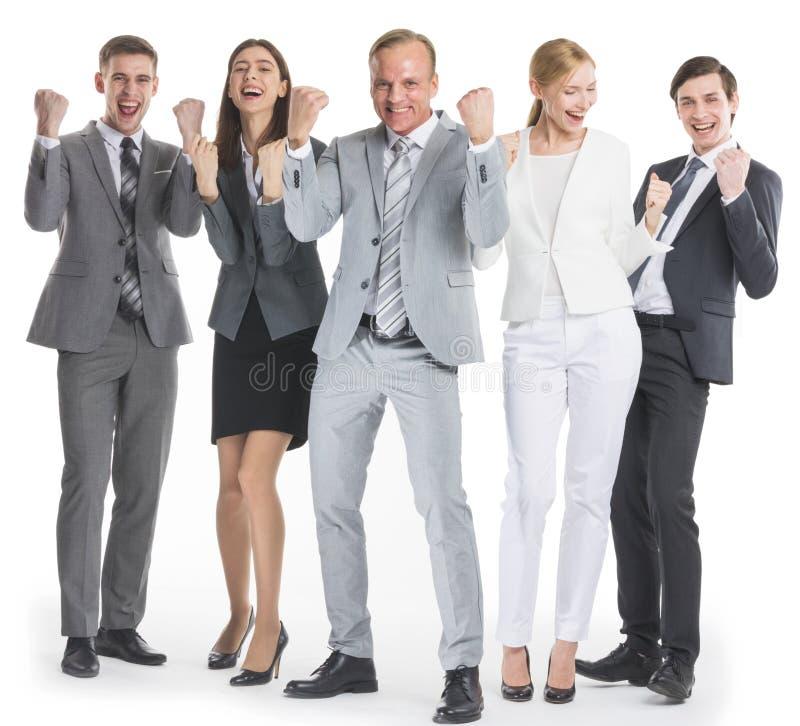 Hombres de negocios que llevan a cabo gesto aceptable del sí del puño foto de archivo